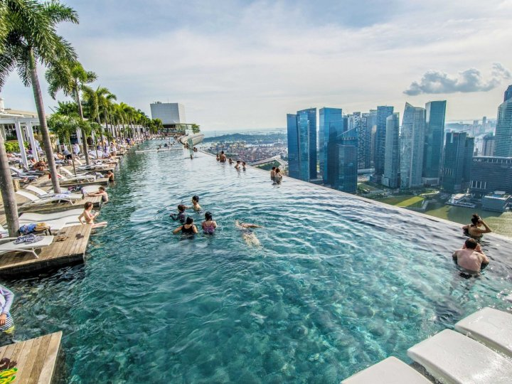 the-marina-bay-sands-hotel-in-singapore-has-a-stunning-infinity-rooftop-pool-on-the-hotels-57th-floor-where-guests-can-swim-and-admire-the-singaporean-skyline