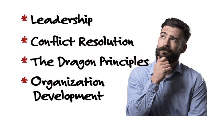 A guy looking with curiosity at list of topics of articles of leadership, conflict resiolution, dragon principles, and organization development