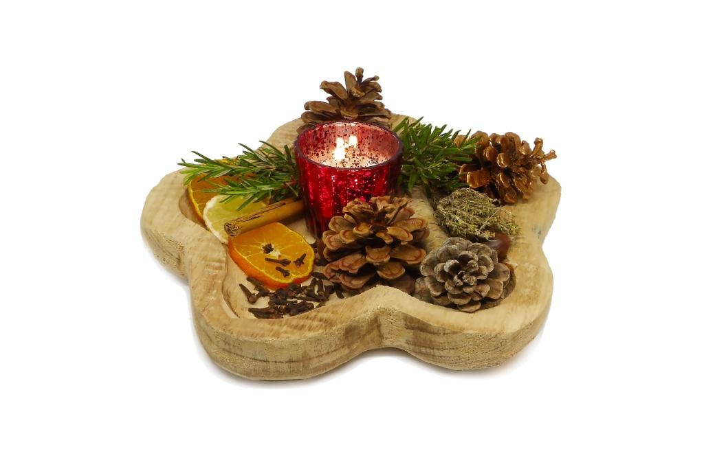 centro de mesa aromatico elaborado con un bol de madera fruta seca hierbas aromaticas y especias piñas y otros ornamentos