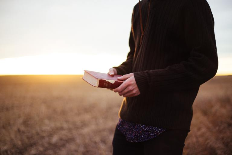 Man holding a Bible