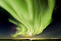 Curtain of northern lights covers full moon at Seal River Heritage Lodge. James-Heupel photo.