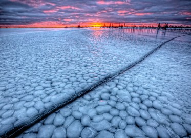 Icescape at sunset. Dymond Lake Ecolodge. Churchill Wild. Robert Postma photo.