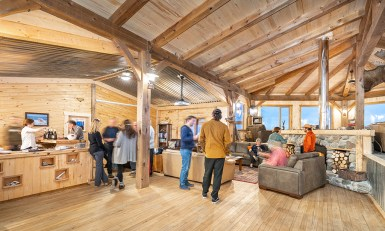 People gathering in lounge at Seal River Heritage Lodge. Scott Zielke photo.