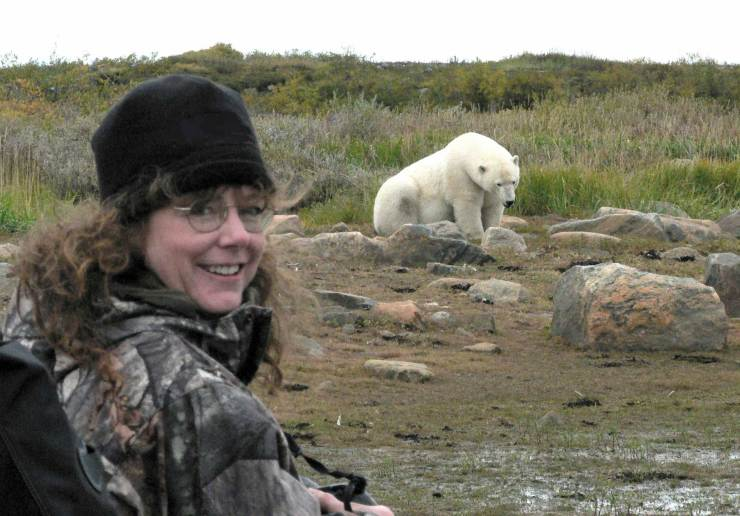 Wildlife artist Linda Besse meets a polar bear at Seal River Heritage Lodge.