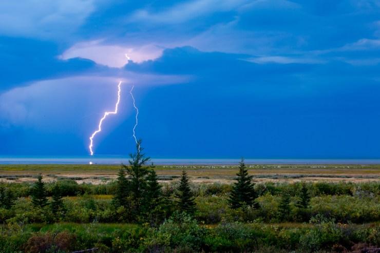 Lighting strikes across the taiga near Nanuk Polar Bear Lodge in northern ManitobaShores