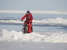 Guide Andy MacPherson tests out one of Churchill Wild's fat tire bikes at the floe edge