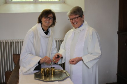 The Reverend Anne Skuse and the Reverend Hazel Minion collect holy oils for use in their parishes.
