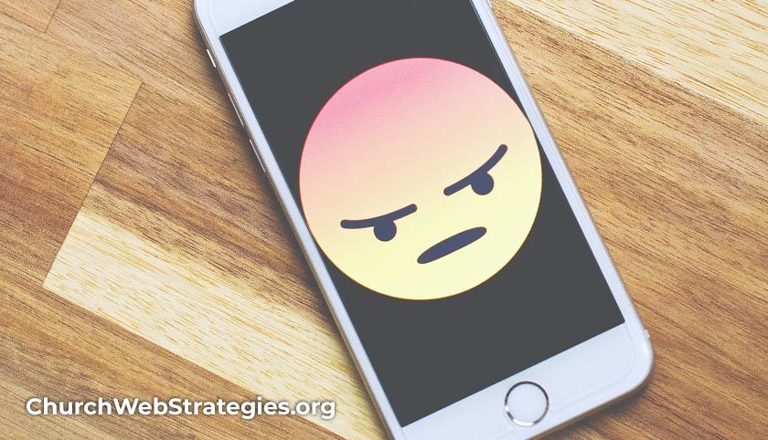 smart phone with angry face icon