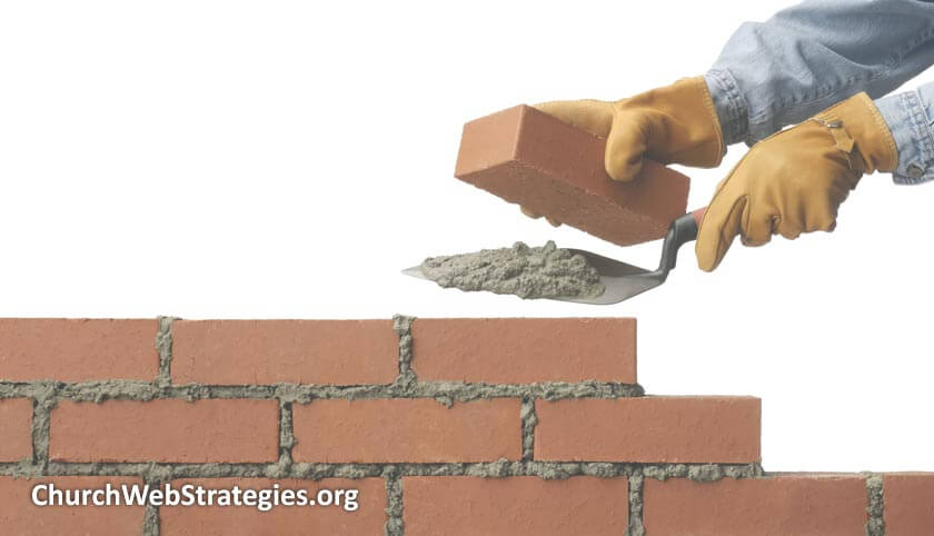 Mason laying bricks