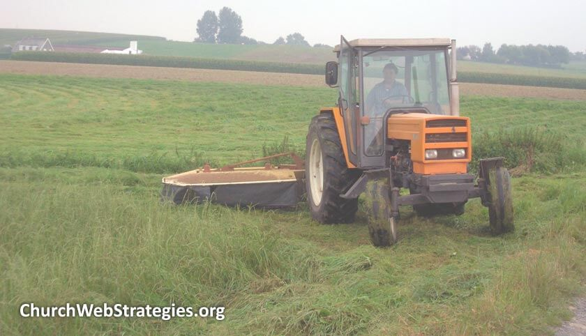 man driving tractor on farm