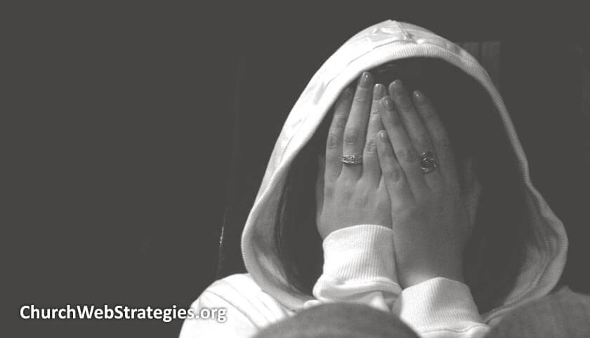 girl hiding her face with her hands
