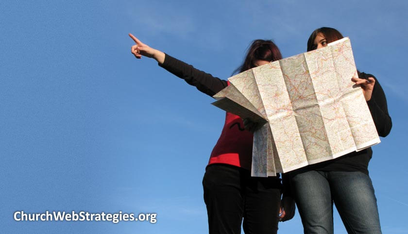 two women looking at a road map