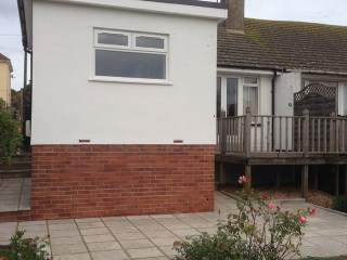 Kitchen extension and block patio