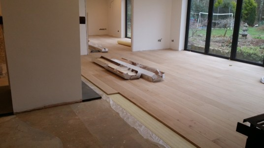 Real wood flooring being fitted.