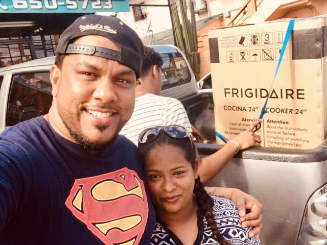 Raymond Ramnarine Provides Some Relief To A Woman Whose House Burnt Down On Diwali Day By A Firecracker