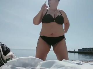 Chubby mommy smoking fetish and stress-free on seashore
