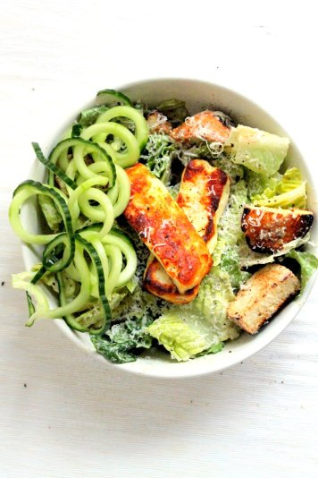 A greek inspired vegetarian caesar salad . Greek yogurt dressing infused with green olives, and halloumi cheese!