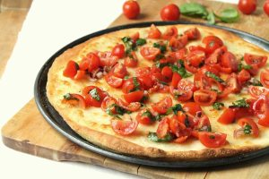 A light, fresh pizza for summer. The crispy thin crust is easy to make and doesn't require any yeast.
