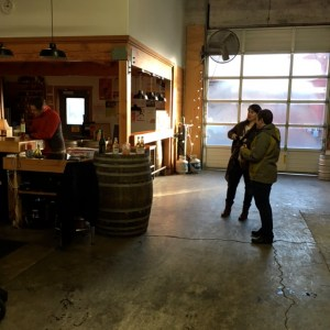 The large window door rolls up letting the TapRoom open to the outdoors