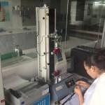 Quality Control Lab - testing adhesive tension