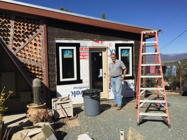 Jim working on the siding