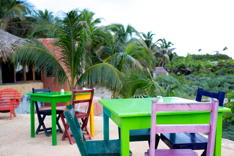 Bright Tables and Chairs on a beach deck