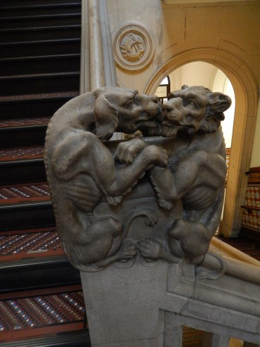 Kissing dogs on the banister!