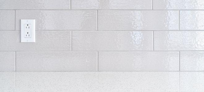 glass tile backsplash around outlets