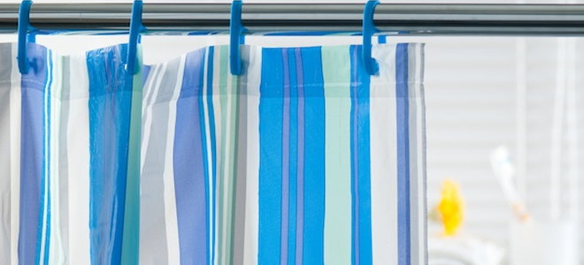 a shower curtain on sloped walls