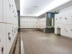 Lockers in the locker room of a gym without people