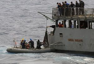 U.S. and Venezuelan Sailors work together during counter-drug operations in 2009.