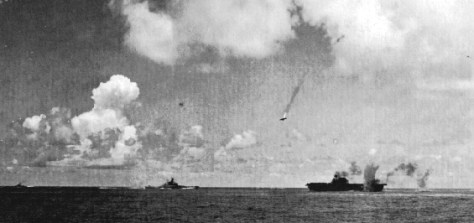 """A Japanese """"Val"""" Dive-Bomber is shot down over the USS Enterprise on October 26, 1942 during the Battle of Santa Cruz (Wikimedia Commons)"""