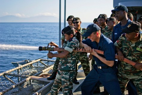 DILI, Timor-Leste (Aug. 27, 2013) Sailors from the Timor-Leste Defense Force practice shipboard fire-fighting techniques alongside U.S. Navy Sailors aboard the amphibious transport dock ship USS Denver (LPD 9). Denver is on patrol with the Bonhomme Richard Amphibious Ready Group, commanded by Amphibious Squadron (PHIBRON) 11, and is participating in Exercise Koolendong with the 31st Marine Expeditionary Unit. (U.S. Navy photo by Mass Communication Specialist 3rd Class Jon Marzullo/Released) 130828-N-ZZ999-013 Join the conversation http://www.facebook.com/USNavy http://www.twitter.com/USNavy http://navylive.dodlive.mil