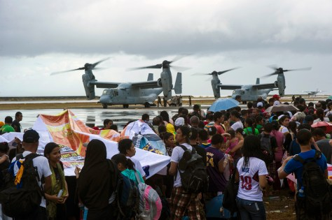 """MV-22 Ospreys assigned to the Marine Medium Tiltrotor Squadron 261, 1st Marine Aircraft Wing, take on supplies to provide aid during """"Operation Damayan."""" The George Washington Strike Group supports the 3rd Marine Expeditionary Brigade to assist the Philippine government in response to the aftermath of Super Typhoon Haiyan/Yolanda in the Republic of the Philippines. Image Credit: CC by U.S. Pacific Command/Flickr."""