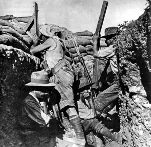 An Australian Sniper peers over a trench in 1915.