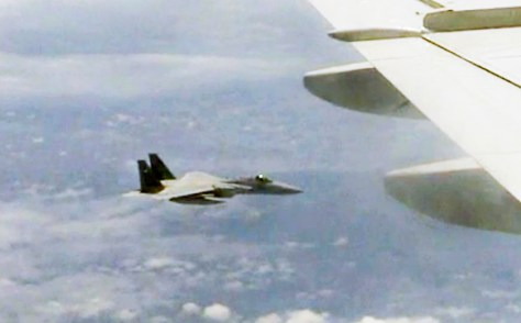 A screenshot from a video posted on the website of China's Ministry of National Defense shows a Japanese fighter jet following Chinese fighter jet. (Handout)