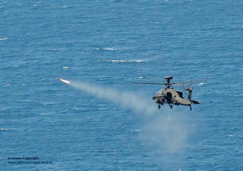 An Apache attack helicopter of 656 Squadron Army Air Corps is pictured firing a Hellfire missile during an exercise conducted from HMS Ocean. Photographer: LA(PHOT) Guy Pool Image 45152700.jpg from www.defenceimages.mod.uk