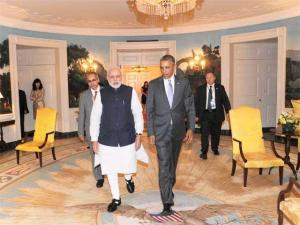 In this photograph released by the Press Information Bureau (PIB) on September 30, 2014, Prime Minister Narendra Modi (centre L) walks with US President Barack Obama at the White House in Washington, DC, on September 29, 2014.