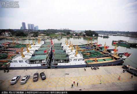 24 December 2015: Tanmen Maritime Militia's newly-delivered 500-ton fishing vessels stand ready at Tanmen Harbor's pier.
