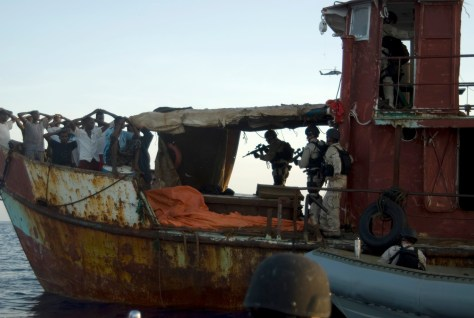 Members of a visit, board, search and seizure team assigned to USS Gettysburg (CG 64) and U.S. Coast Guard Tactical Law Enforcement Team South Detachment 409 detain suspected pirates after responding to a merchant vessel distress signal while operating in the Combined Maritime Forces area of responsibility in the Gulf of Aden May 13, 2009. The service members are conducting the operation in support of Combined Task Force 151, a multinational task force established to counter piracy operations and to actively deter, disrupt and suppress piracy in order to protect global maritime security and secure freedom of navigation for all nations. (DoD photo by Mass Communication Specialist 1st Class Eric L. Beauregard, U.S. Navy/Released)