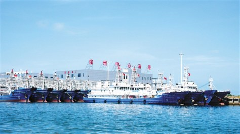 18 June 2016: Newly-built fishing vessels for Sansha City moored at Yazhou Central Fishing Harbor. Note the exterior hull reinforcements and mast-mounted water cannons. (Hainan Government)