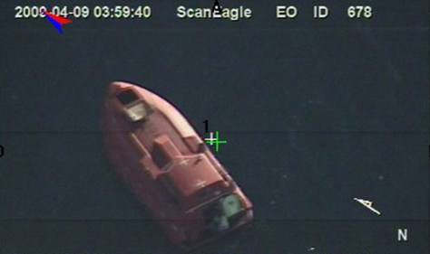 090409-N-0000X-926 INDIAN OCEAN (April 9, 2009) In a still frame from video released by the U.S. Navy taken by the Scan Eagle unmanned aerial vehicle, a 28-foot lifeboat from the U.S.-flagged container ship Maersk Alabama is seen Thursday, April 9, 2009 in the Indian Ocean. (U.S. Navy Photo)