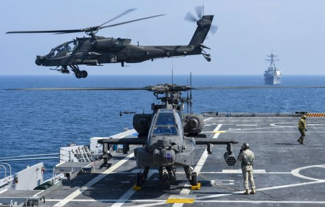 A U.S. Army AH-64D Apache helicopter takes off from Afloat Forward Staging Base (Interim) USS Ponce (AFSB(I) 15), during an exercise. Ponce, formerly designated as an amphibious transport dock ship, was converted and reclassified to fulfill a long-standing U.S. Central Command request for an AFSB to be located in the U.S. 5th Fleet area of responsibility. (U.S. Navy photo by Mass Communication Specialist 1st Class Jon Rasmussen/Released)