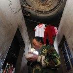 Decine di famiglie cinesi vivono in silos di cemento: le immagini