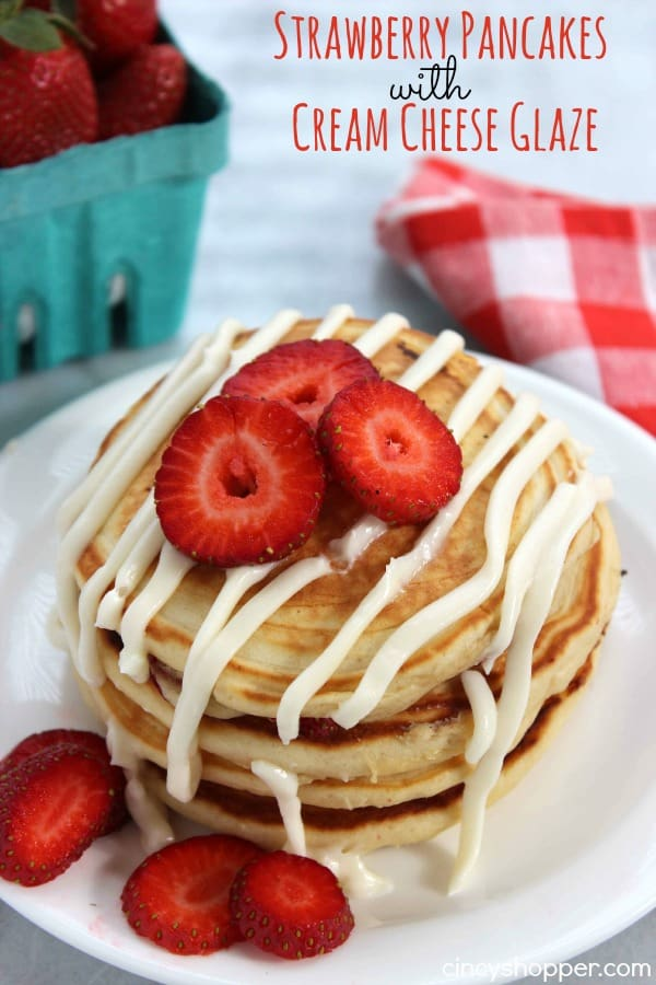 Strawberry Pancakes with Cream Cheese Glaze- pancakes are made with fresh strawberries and then topped with a sweet cream cheese glaze. Perfect for a wonderful weekend or even Valentine's breakfast!