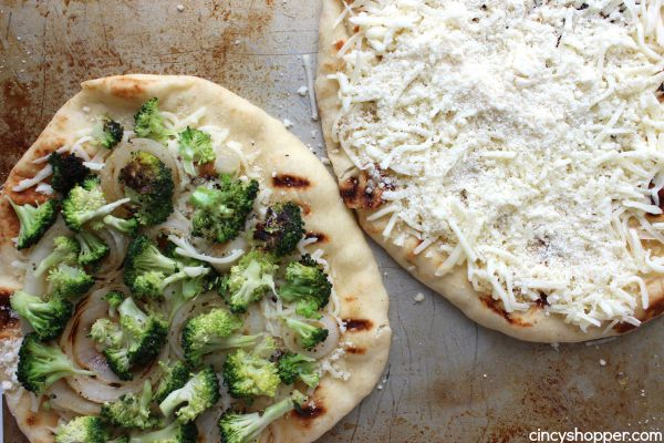 Broccoli Flatbread Pizza -loaded with broccoli, onions, cheese and lots of garlic. A super easy and quick weeknight meal that is sure to please.