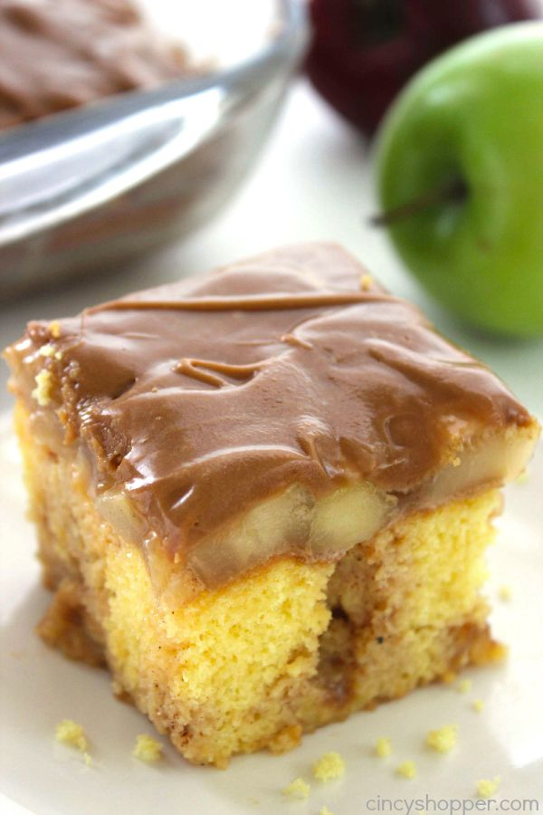 Caramel Apple Poke Cake -loaded with great cinnamon, apples and caramel. Perfect for serving at your next fall potluck.