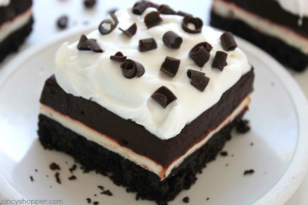 Chocolate Lush Bars - Perfect No Bake dessert. Oreo cookie crust tastes amazing with the cream cheese and chocolate pudding layer.