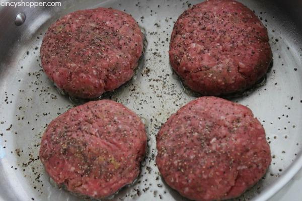 hamburger patties in pan