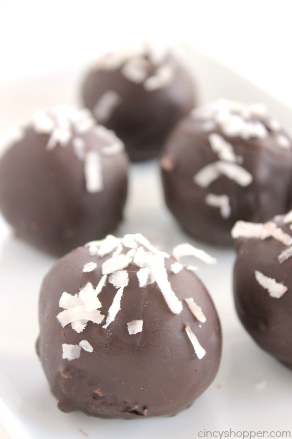 Coconut Truffles - great candy for Christmas. Amazing coconut cream filling coated in dark chocolate. Perfect for dessert or even for gifting.